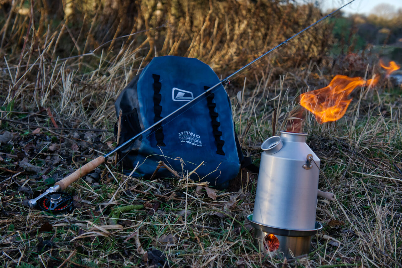 making coffee beside river during guided fly fishing trip