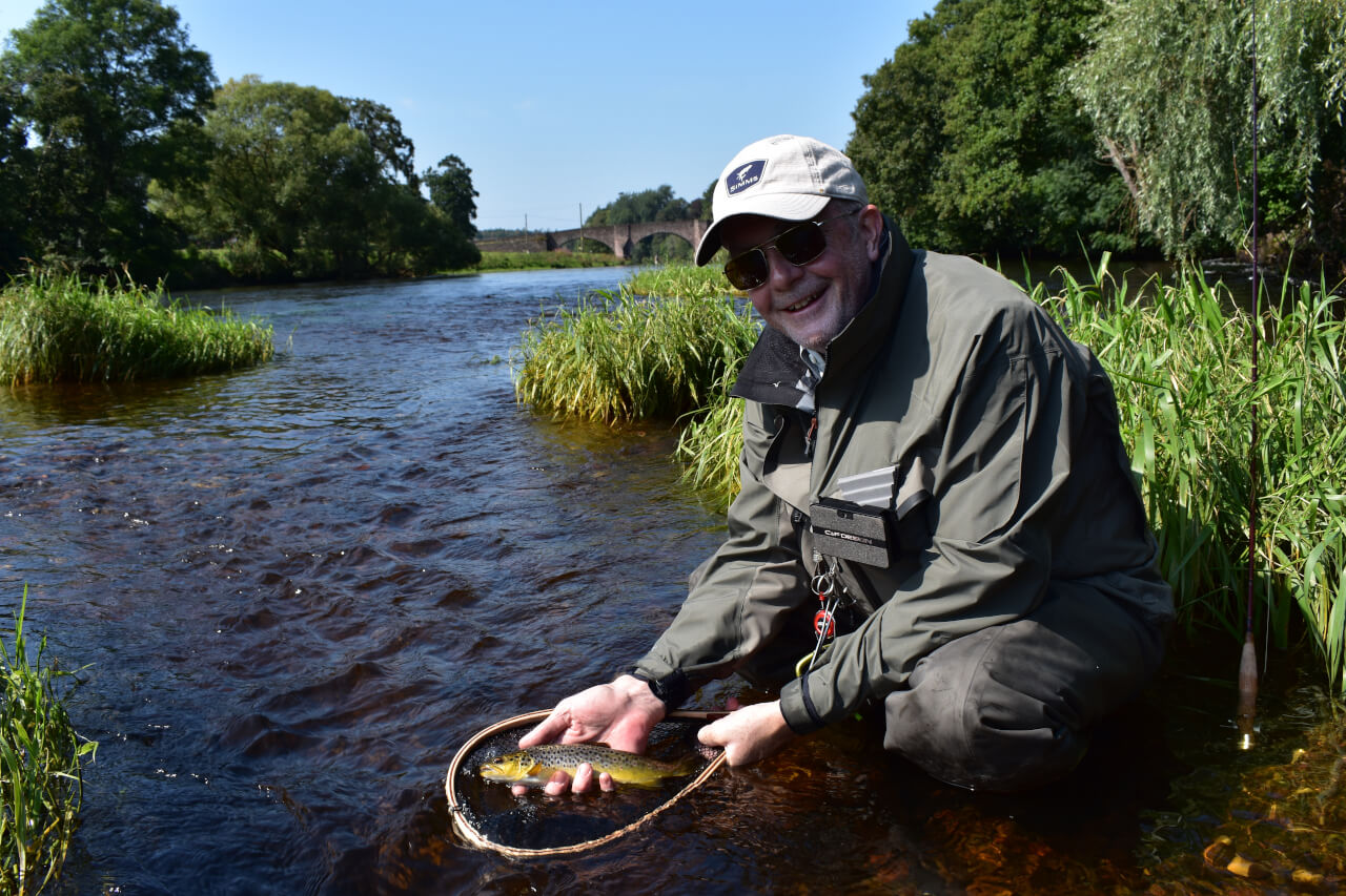 guided brown trout fishing on river in Scotland