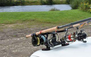 fishing rods on vehicle beside scottish river